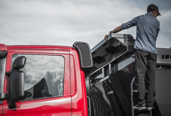 Truck Driver Checking the Load - Stock Photo - Images
