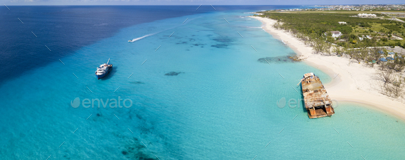 Aerial panorama of Grand Turk with clear water, boats, and shipw - Stock Photo - Images