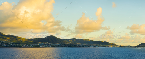 Panoramic view of St Kitts from the sea during golden hour at da - Stock Photo - Images
