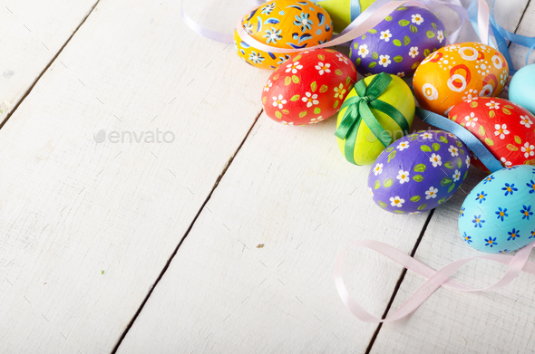 Painted decorated easter eggs on white table - Stock Photo - Images