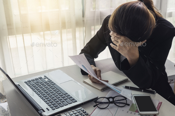 Stressed and frustrated asian business woman - Stock Photo - Images
