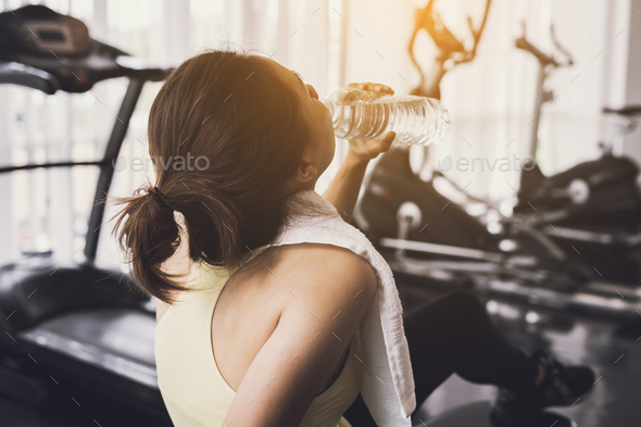 Fitness woman drinking water after work out - Stock Photo - Images