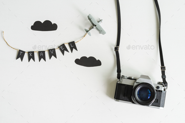 Retro camera with airplane toy on white background, Travel concept - Stock Photo - Images