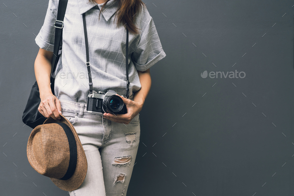 Young asian woman traveler with retro camera and backpack - Stock Photo - Images