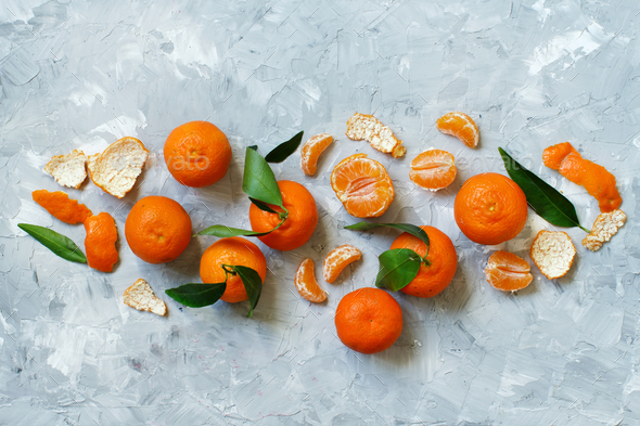 Mandarins with leaves  on a grey background - Stock Photo - Images