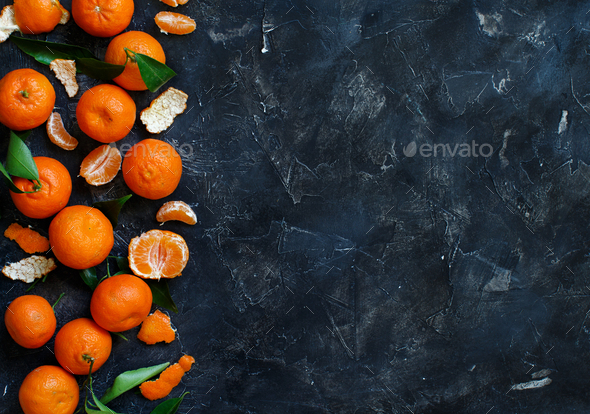 Mandarins with leaves  on a black background - Stock Photo - Images