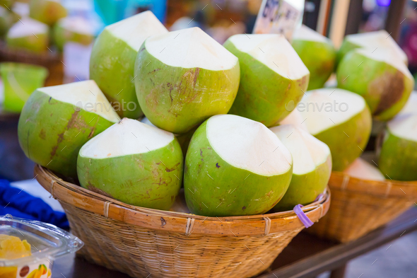 Coconuts For Sale At Street Market - Stock Photo - Images