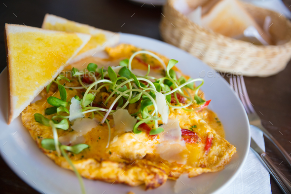 Spanish Omelette Served With Bread Slices On Table - Stock Photo - Images