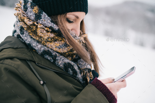 Woman using mobile smartphone - Stock Photo - Images