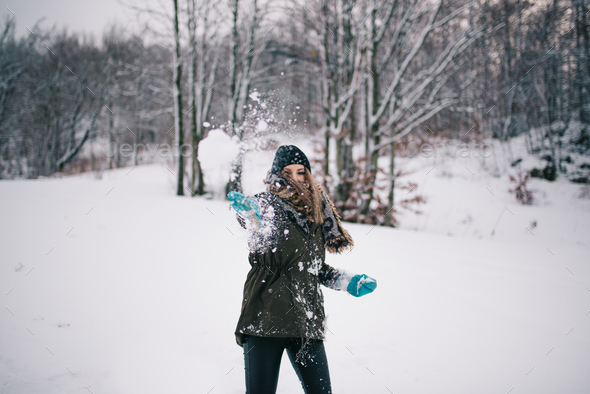 Throwing snowball - Stock Photo - Images