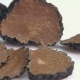 Pieces Black Truffle on a White Surface - VideoHive Item for Sale