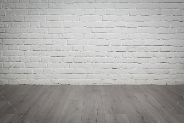 Old white brick wall and wood floor background - Stock Photo - Images