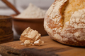 Homemade bread on old cutting board with a pile of fresh yeast - PhotoDune Item for Sale
