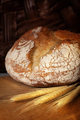 Homemade bread loaf on old cutting board - PhotoDune Item for Sale