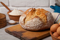 Homemade bread on old cutting board - PhotoDune Item for Sale