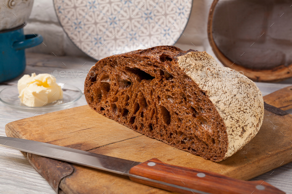Homemade rye bread on old cutting board - Stock Photo - Images