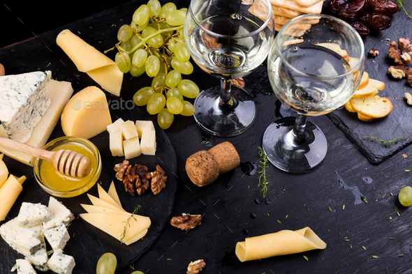 Cheese plate. Assortment of cheese - Stock Photo - Images