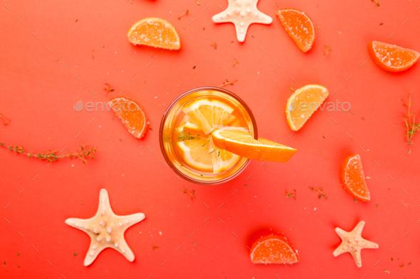 Orange fruit cocktail, detox water on orange background - Stock Photo - Images