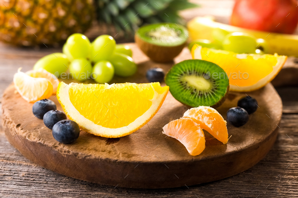 Fresh fruits on wooden background - Stock Photo - Images