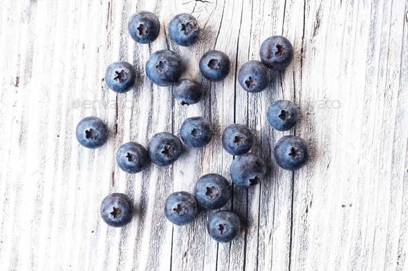 Blueberry on wooden background - Stock Photo - Images