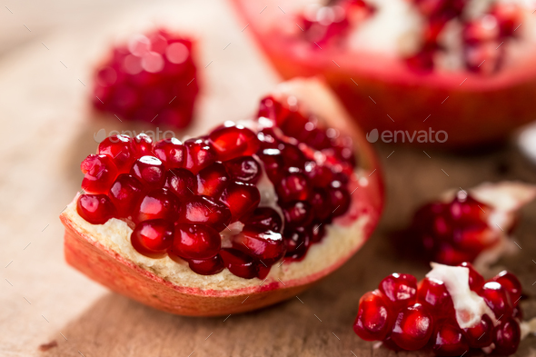 Pomegranate on wooden background - Stock Photo - Images