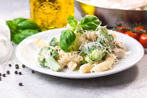 Pasta with broccoli, chicken and cream - Stock Photo - Images