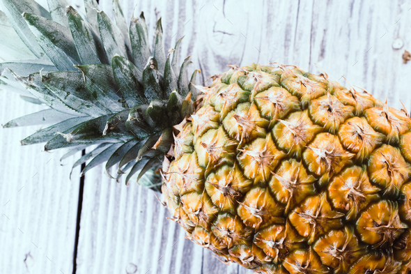 Pineapple on wooden background - Stock Photo - Images