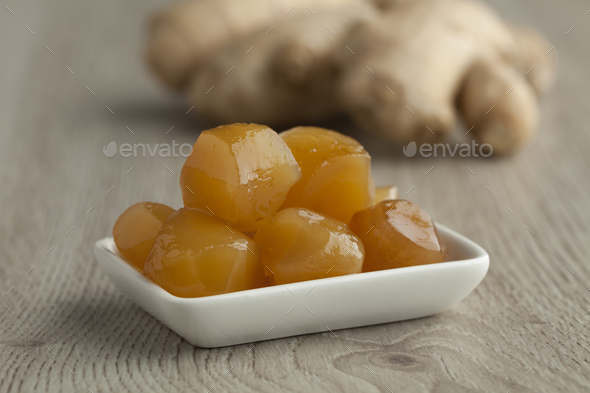 Dish with stem ginger in syrup - Stock Photo - Images