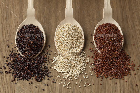 Spoons with red, white and black quinoa - Stock Photo - Images