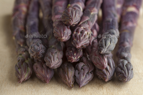 Heap of purple asparagus - Stock Photo - Images
