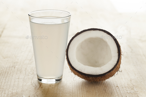 Coconut with a glass of coconut water - Stock Photo - Images