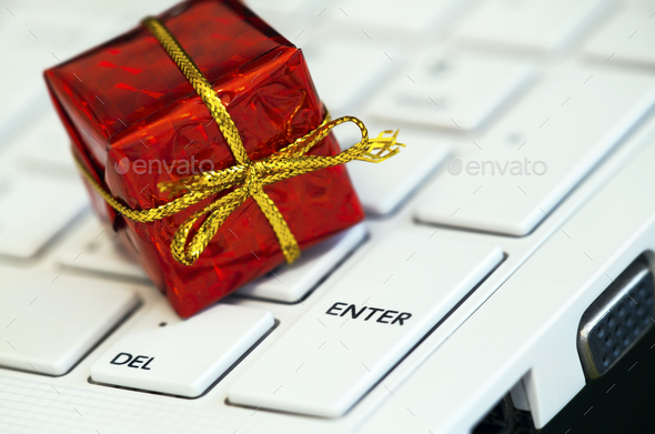 Red gift-box on a keyboard - Stock Photo - Images