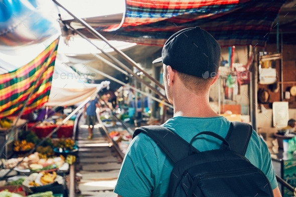 Tourist on the railway market - Stock Photo - Images