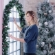 Cute Blonde Model Posing near Window and Christmas Tree - VideoHive Item for Sale