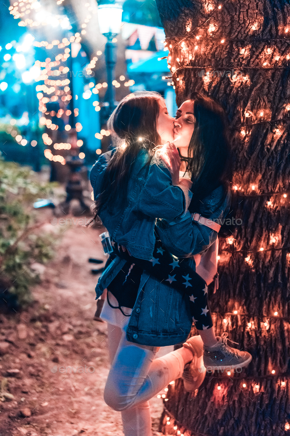 mom kisses her daughter in the evening park - Stock Photo - Images