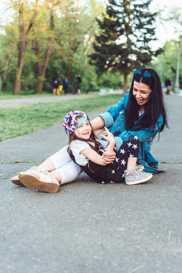 mom and little girl have fun - Stock Photo - Images