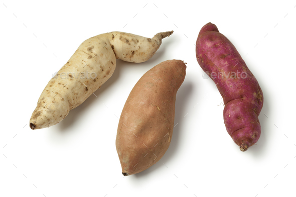 Purple, white and orange sweet potatoes - Stock Photo - Images