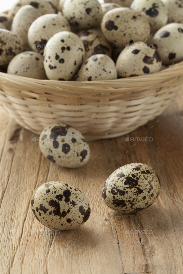 Basket with raw Quail eggs - Stock Photo - Images