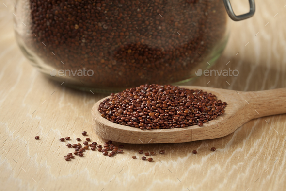 Black Quinoa on a wooden spoon - Stock Photo - Images