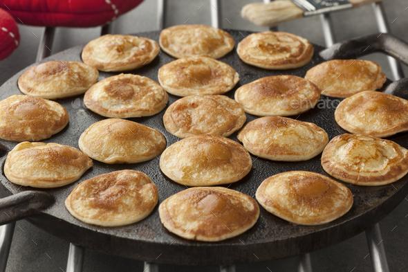 Baking Dutch mini pancakes called poffertjes - Stock Photo - Images