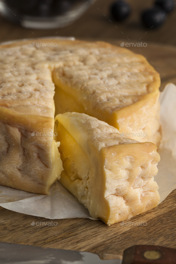 Epoisses cheese and wedge close up - Stock Photo - Images
