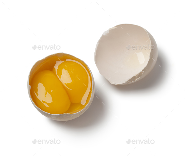 Broken double yolk egg in the shell - Stock Photo - Images