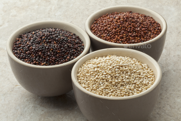 Bowls with red, white and black quinoa - Stock Photo - Images