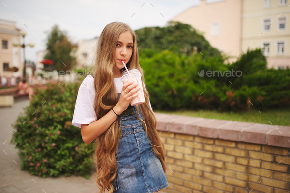 beautiful young girl with long hair - Stock Photo - Images