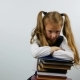 First Grade School Girl Sits Leaning on Books with a Weary Look - VideoHive Item for Sale
