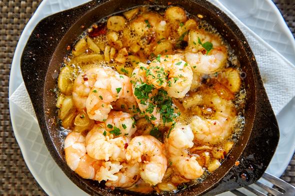 Pan of Garlic prawns - Stock Photo - Images