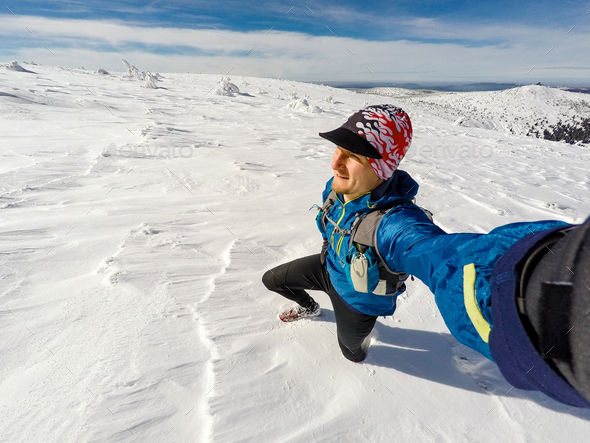 Trail runner selfie in winter mountains - Stock Photo - Images