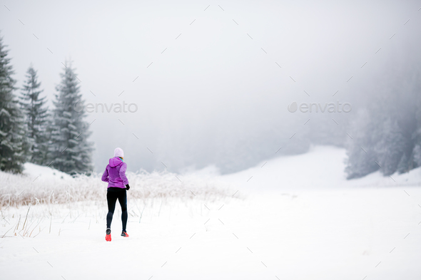 Trail running woman in winter mountains - Stock Photo - Images