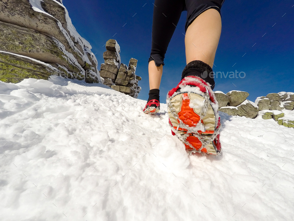 Running woman on winter trail, snow and white mountains - Stock Photo - Images