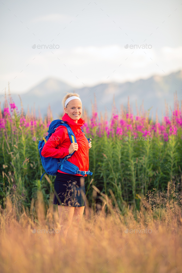 Woman hiking in mountains, adventure and travel - Stock Photo - Images